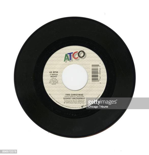A 45rpm record of Donny Hathaway's This Christmas written by Nadine McKinnor and Donny Pitts Produced by DonRic Enterprises arranged by Donny...