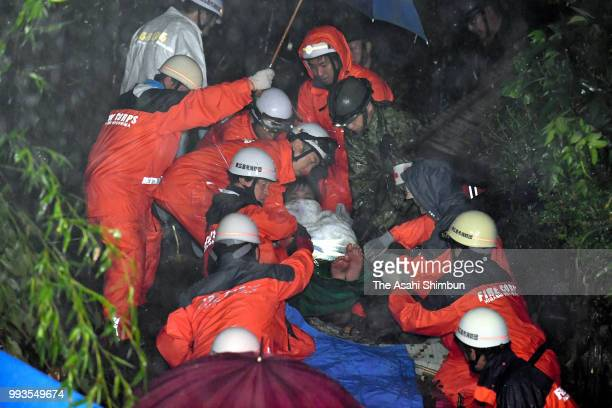 45yearold Seiji Tonohata is rescued 24 hours after a landslide hit his house on July 7 2018 in Higashihiroshima Hiroshima Japan 51 people were killed...