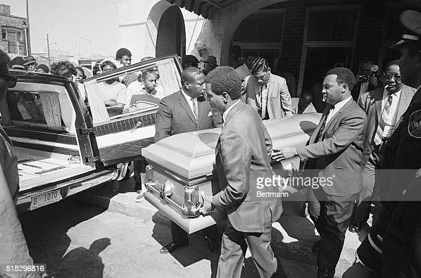 The casket bearing the body of Dr Martin Luther King is being carried out of the funeral home here for transport to the Sisters Chapel at Spellman...