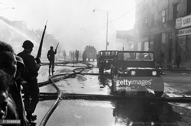 4/6/1968ChicagoIL The Illinois National Guard patrol this riotscarred area of the City's West side Police say at least nine persons have been killed...