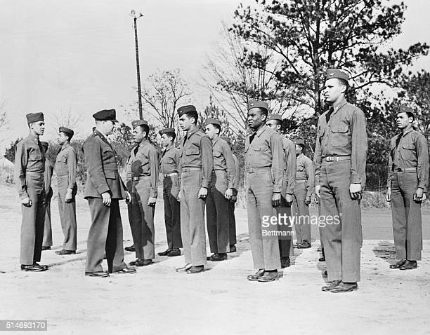 Maj Gen Ralph Royce Commanding General of the Army Air Force training center inspects Negro Aviation cadets at the flying training detachment here...