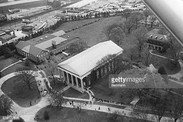 Atlanta, Georgia: Aerial view shows winding line of people almost completely covering the campus of tiny Spelman College as they file into Sisters...