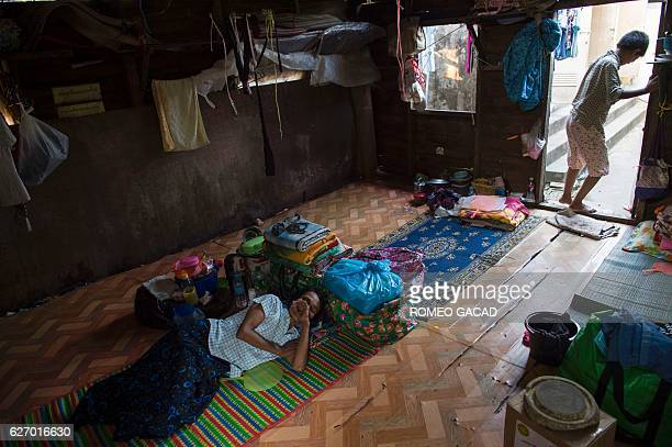 A 47year old Myanmar widowed wife living with HIV virus rests at the National League for Democracy HIV/AIDS Center with 158 patients in their two...