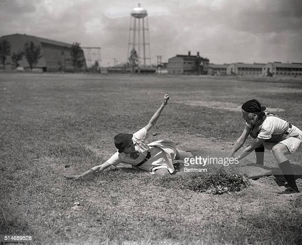 4/8/1948Opa Locke FL Sophie Kurys of Flint MI member of the Grand Rapids MI Chiks demonstrates her sliding ability during spring training here for...