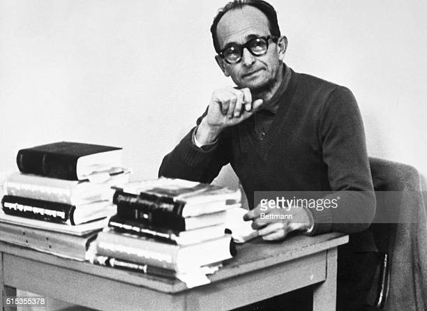 4/8/1961Jerusalem Israel Nazi War Criminal Adolf Eichmann sits pensively before a pile of books in his cell at the Teggart fortress where he is being...