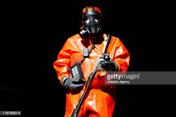 48yearold Sanli Akyuz poses for a photo with his hazmat suit ahead of a drill conducted by Diyarbakir Turkey's National Disaster Management Agency...
