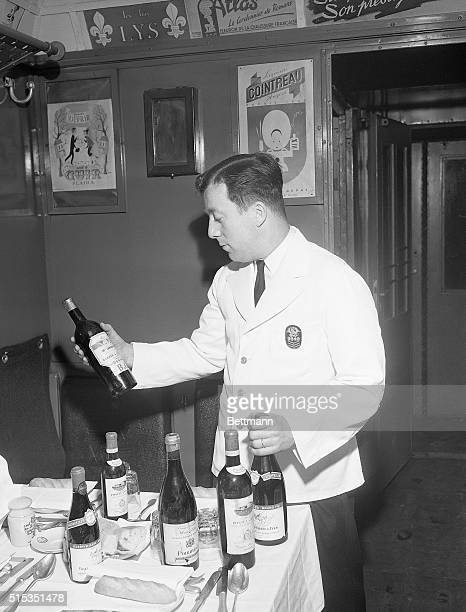 4/9/1951Paris France Photo shows Eugene Monnier Head Waiter famous for his ability to chose wine In the SimplonOrient Express six kinds of bourgogne...