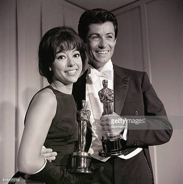 4/9/1962Santa Monica California Actress Rita Moreno 'Best Supporting Actress' and George Chakiris 'Best Supporting Actor' are shown with their Oscars...