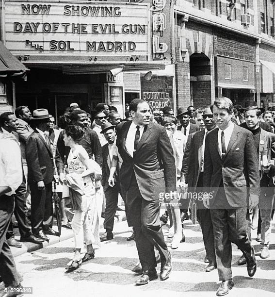 GA New York Senator Robert Kennedy marching in the funneral procession honoring fallen Civil Rights leader Dr Martin Luther King Jr passes a...