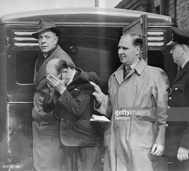 4/9/53London England Covering his face John Christie charged with the murder of his wife Ethel arrives for a second appearance at West London...
