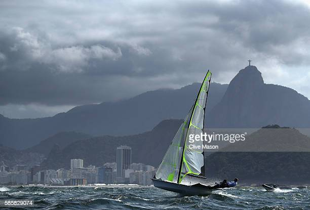 49er class skiff in action against the backdrop of Copacabana beach and Christ The Redeemer during practice ahead of the Rio 2016 Olympic Games at...