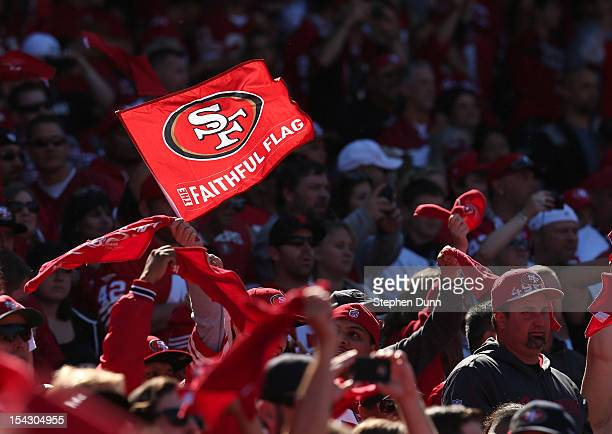 49er fan waves a flag in the game between the New York Giants and the San Francisco 49ers at Candlestick Park on October 14, 2012 in San Francisco,...