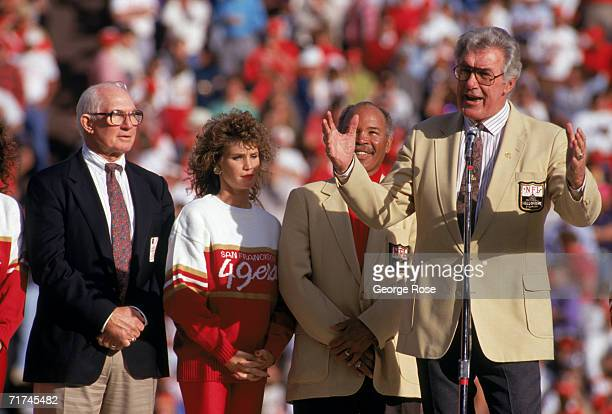 49ers Hall of Famers Y.A. Tittle, Joe Perry stand next to Bob St. Clair who speaks to the fans during a game between the San Francisco 49ers and...