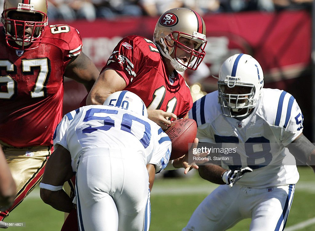 49ers quarterback Alex Smith is sacked by Colts linebacker David Thornton as the Indianapolis Colts defeated the San Francisco 49ers by a score of 28 to 3 at Monster Park, San Francisco, California, October 9, 2005.