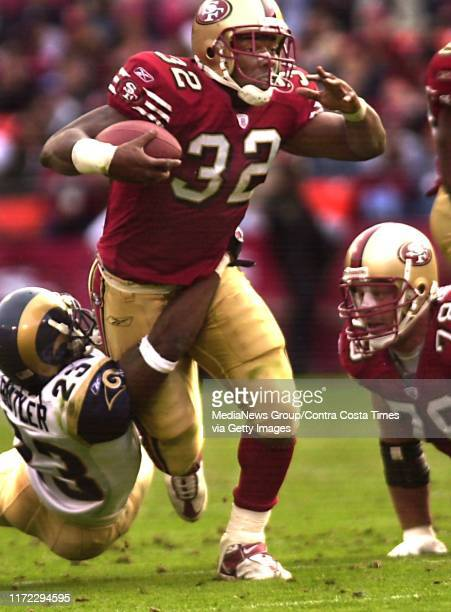 49ers running back Kevan Barlow tries to run past St Louis Rams defender Jerametrius Butler during the second half their NFL football game at 3 Com...