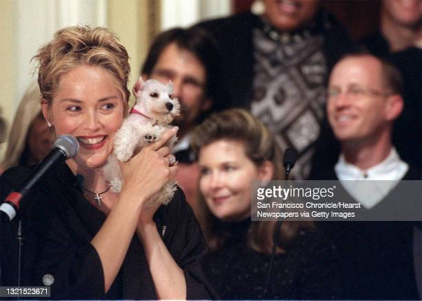 Sharon Stone auctions off a Schnauzer puppy at Sir Francis Drake Hotel to benefit Cecil Williams' Glide Community House. Photo by Liz Hafalia