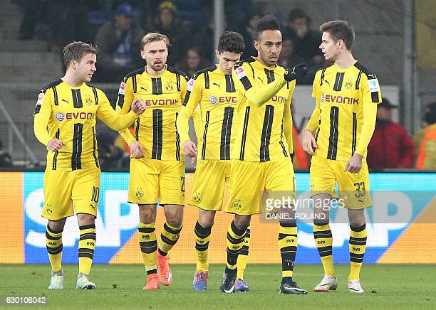 4Dortmund's Gabonese forward PierreEmerick Aubameyang celebrates scoring the 22 with his teammates vie for the ball during the German first division...