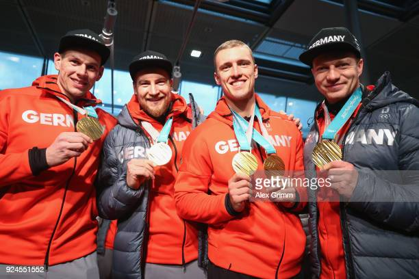 4man Boblseigh olympic champions Francesco Friedrich Candy Bauer Martin Grothkopp and Thorsten Margis pose with their gold medals during the welcome...