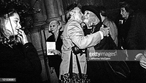 American actor and filmmaker Dennis Hopper center greets actress Sylvia Miles while his future wife Victoria Duffy looks on at the memorial service...