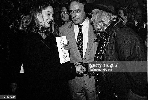 American actor and filmmaker Dennis Hopper center introduces future wife Victoria Duffy to actress Sylvia Miles at the memorial service for artist...