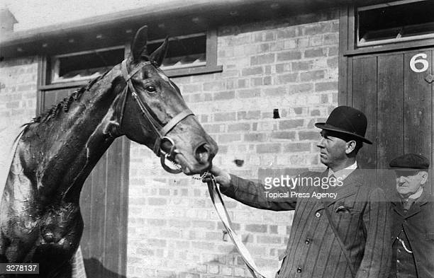 Trainer R Gore with 'Covercoat' the winner of the Grand National