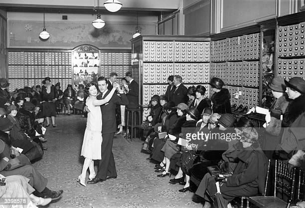 Customers watching mannequins dancing the foxtrot at a display at Messrs Cennards' shoe shop