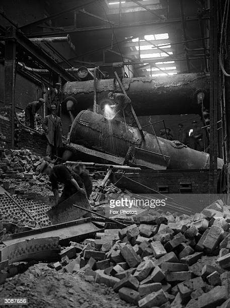 Welders demolishing the old boilers at the Metro Power Station in Neasden London to make room for a modern high pressure steam raising plant for the...
