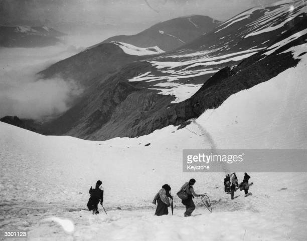 Spanish refugees fleeing from their own homes towards Luchon a border town in France over the snow covered Piccade Mountains.
