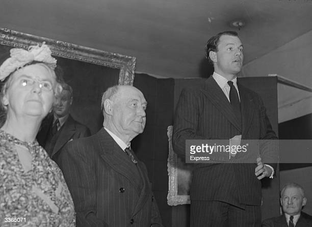 Newspaper publisher Max Aitken and SIr Francis Joseph attend a 'Tribute to Genius' exhibition in honour of R J Mitchell designer of the spitfire