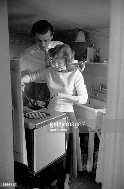 British actors Lawrence Ward and Susan Stephens cooking breakfast together in their country cottage shortly after their marriage Original Publication...