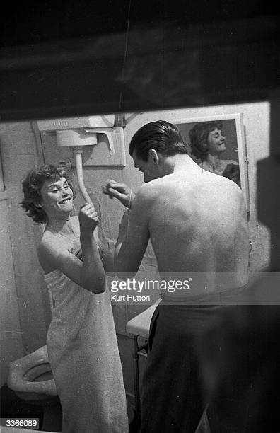 British actors Susan Stephen and Lawrence Ward playfighting in the bathroom of their country cottage shortly after their marriage Original...