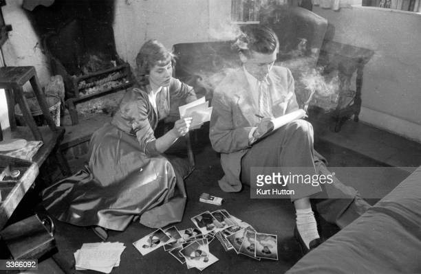 British actors Susan Stephen and Lawrence Ward reading their fan mail by the fireplace of their country cottage shortly after their marriage Original...