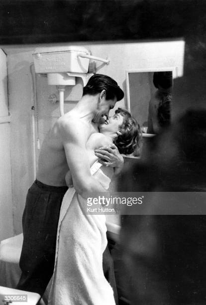 British actress Susan Stephen star of such films as 'His Excellency' 'Father's Doing Fine' and 'The Red Beret' kissing Lawrence Ward her husband of...