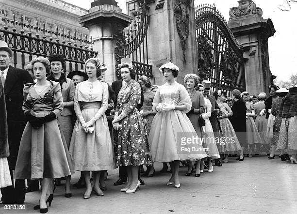 Debutantes and their families queuing for entry to a Presentation Party at Buckingham Palace