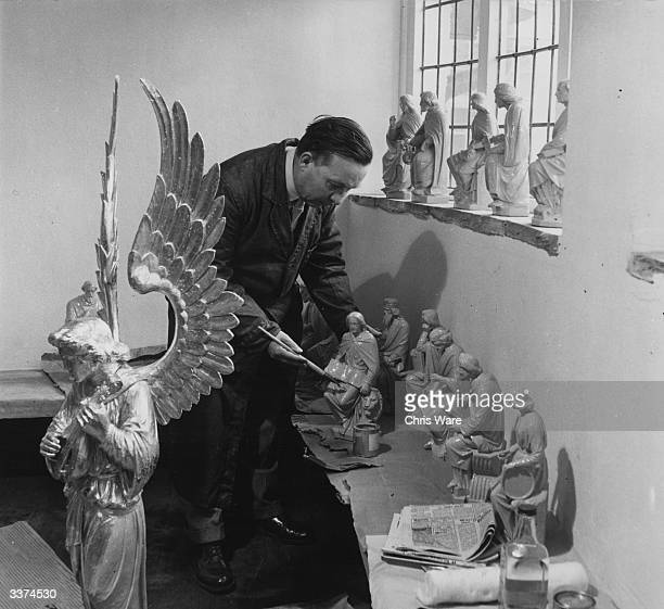 Mr William Leetham of York working on some of the statues that will surround Sir Jacob Epstein's statue of Christ in Llandaff cathedral in Cardiff...