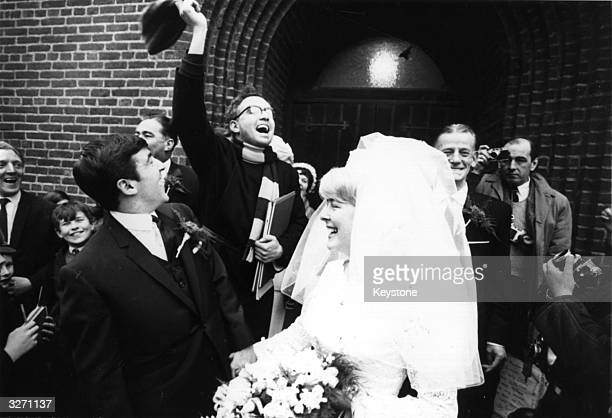 Chelsea and England footballer Terry Venables outside St Cedd's Church London with his bride Christine McCann Behind them the vicar Robin Bennett an...