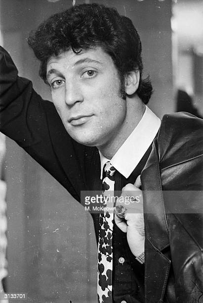 Welsh singer Tom Jones goes shopping in Gear, a boutique in London's fashionable Carnaby Street.