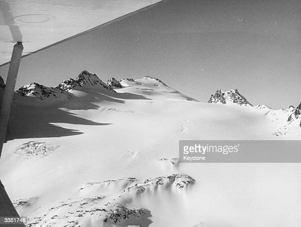 The view beneath the plane 'Pilatus Porter' as it prepares to land on the snowy mountainside of the Rose Blanche in the Swiss Alps