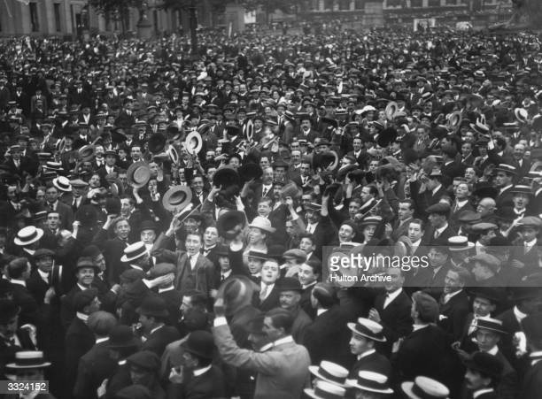 Crowds many waving boaters cheer Britain's declaration of war on Germany in Trafalgar Square London