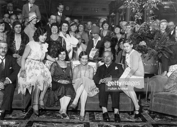 English aviator Amy Johnson centre with her family at the Grosvenor House hotel in London after arriving back in Britain following her pioneering...