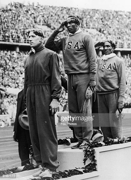 100 metres medallists at the 1936 Berlin Olympic games left to right Martinus Osendarp of Holland Jesse Owens of the USA and Ralph Metcalf also of...