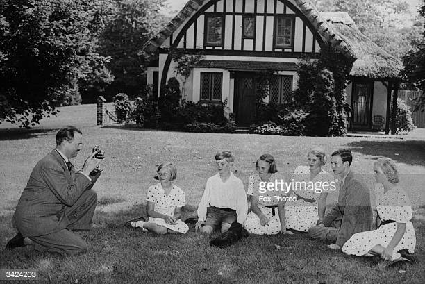 Prince Felix of Luxembourg taking a photograph of his family Princess Alix Prince Charles Princess Marie Gabrielle Princess Marie Adelaide Prince...