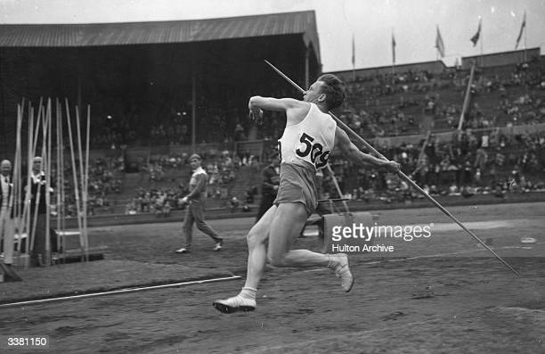 G Petterson throwing the Javelin in the qualifying rounds at the 1948 London Olympics at Wembley Stadium London