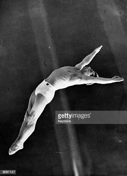 Lennart Brunnhage of Sweden in action during the men's platorm diving event at the 1948 London Olympics at the Empire Pool Wembley he was placed 4th...