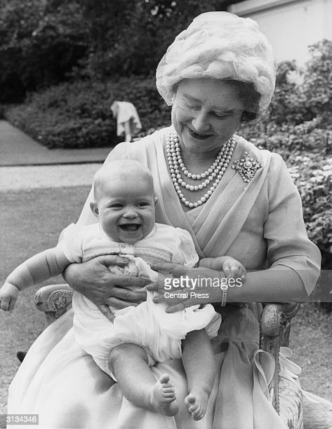 Elizabeth the Queen Mother holds her sixmonthold grandchild Andrew on her lap during her 60th birthday celebrations at Clarence House London