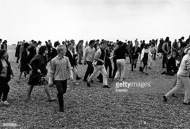 A crowd of Mods join the rioting between Mods and Rockers on the beach at Hastings