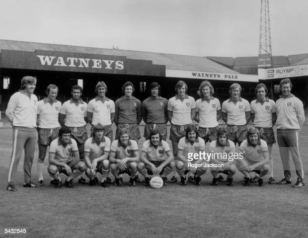 The players of Norwich City Football Club pose for a team photograph on the pitch at Carrow Road Stadium In the back row from left to right are John...