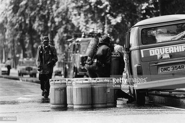 Roy Sainsbury the Greater London Council Scientific officer supervising the five men commissioned to unload 50 gallons of acid from a Volkswagen van...