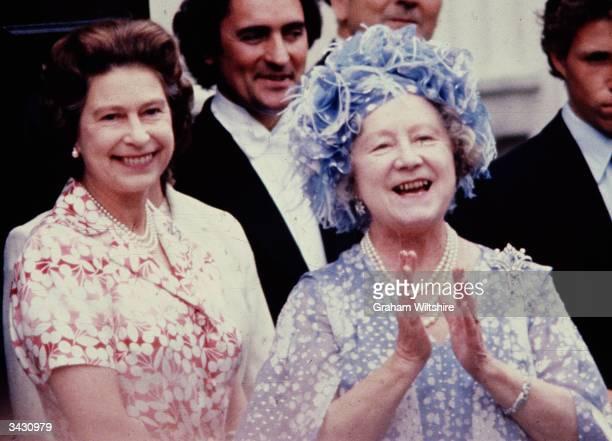 Elizabeth the Queen Mother celebrates her 80th birthday in the company of her daughter Queen Elizabeth II