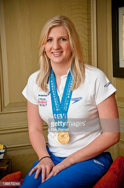 British swimmer Rebecca Adlington posed with her 2011 World Championship gold medal at the Charlotte Street hotel in London on 4th August 2011.